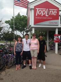 Heidi Feehan and her son Nick (middle) made the trek from Big Lake, MN to TopLine Como Park to donate their bikes. Mary McKeown (left) and Ignacio Rivera (right) from Keystone/Bike Express.
