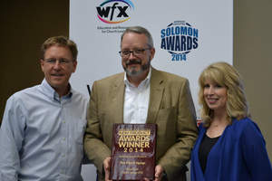 Piksel Faith's VP of Sales, Alan Riley (center) accepts the Worship Facilities New Product Award