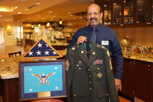 Oakwood Common's Dining Services General Manager, Steve Berry, displays his Army uniform and memorabilia from 24 years of military service.