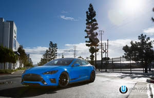 Unplugged Performance Tesla Model S Debuts at SEMA with new front fascia and slew of new parts.