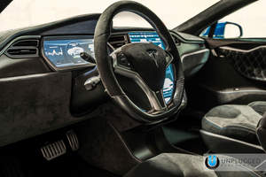 The Unplugged Model S debuted a fully customized interior at SEMA.