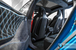 Unplugged Performance carbon fiber seat backs highlight fully customized Tesla interior.