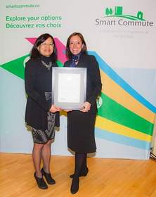 Leslie Woo, Vice President - Policy, Planning and Innovation, Metrolinx, presents Smart Commute Employer of the Year Award to AMD's Jaye Block at annual Smart Commute event on Wednesday, November 26, 2014