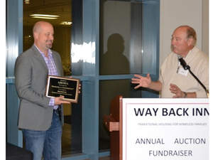 Dave Caple accepts award from Way Back Inn for ABODA employees