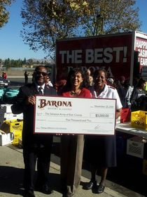 Barona Resort & Casino staff members unload a truck filled with food collected for East County families.