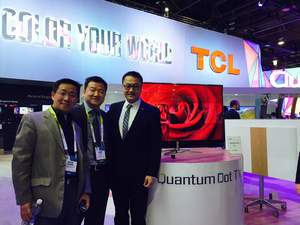 """Mr. E Hao (right), CEO of TCL Multimedia, Mr. Jason Yin (middle), Vice Present of ShineOn, and Mr. Kevin Zhang (left), COO of ShineOn, demonstrate a 55"""" Quantum Dot TV at CES 2015."""