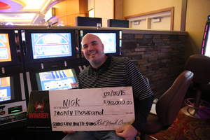 Nick, from Fair Oaks, Calif., celebrates a $20,000 jackpot at Red Hawk Casino.