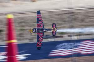 Kirby Chambliss of the United States races during the the seventh stage of the Red Bull Air Race World Championship at the Las Vegas Motor Speedway in Las Vegas, Nevada, United States on October 11, 2014. Photographer Credit: Balazs Gardi/Red Bull Content Pool