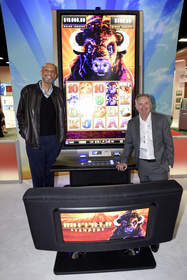 Kareem Abdul-Jabbar, one of the biggest NBA legends of all time, left, and Aristocrat Leisure Limited CEO Jamie Odell, right, with the world's biggest slot machine, the new Behemoth(TM) from Aristocrat(TM), at NIGA's 2015 Indian Gaming Tradeshow and Convention in San Diego on April 1.