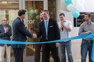 Home automation company Zonoff hosted a ribbon cutting event at its new Malvern, PA headquarters on April 23. Shaking hands are Zonoff CEO Mike Harris (r) and US Congressman Ryan Costello (PA-6). Photo credit: Alicia's Art, LLC