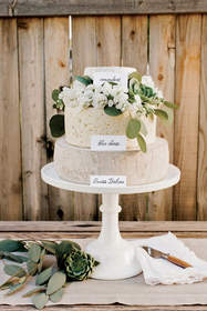 Cheese wheels styled into a wedding cake.