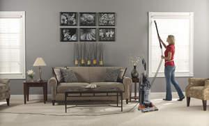 woman vacuuming drapes