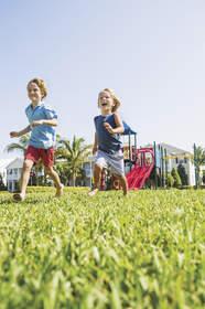 kids running in the grass