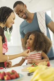Family sharing fruit