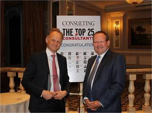 "Stefan Larsson, a Stockholm-based senior partner of The Boston Consulting Group (BCG), poses with his ""Top 25"" most influential consultants award from Consulting magazine at a gala dinner June 18 at the Pierre hotel in New York. Ross Love, head of BCG's New York office, is at right."
