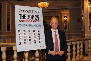 "Stefan Larsson, a Stockholm-based senior partner of The Boston Consulting Group (BCG), poses with his ""Top 25"" most influential consultants award from Consulting magazine at a gala dinner June 18 at the Pierre hotel in New York."