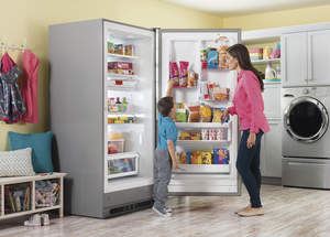 Woman and child opening up a freezer.