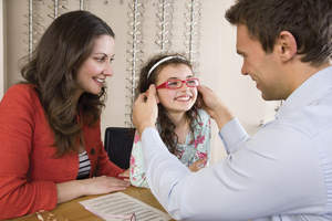 Child being fitted for glasses