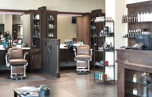 Two of eight, modern semi-private barber stations at Roosters Men's Grooming Center in San Diego's East Village.