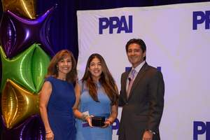 PPAI's Tina Filipski, left, and Paul Bellantone, right, present Sasha Pirrie as a 2015 PPB Rising Star.