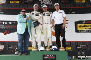 DEKRA congratulates #911 Porsche North America's Porsche 911 RSR as the winner, for the second time, of the DEKRA Green Challenge Award at the Oak Tree Grand Prix at VIR race held in Danville, VA on August 23, 2015.  Pictured (left to right) are Donald O. Nicholson, CEO and President of DEKRA North America, Porsche Drivers Nick Tandy and Patrick Pilet, and Project Manager Steffen Hoellwarth.