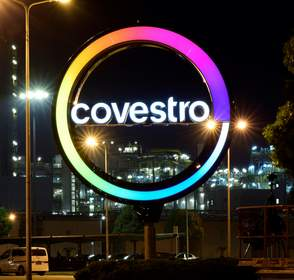 The new Covestro logo lights the night sky at the site in Shanghai, China