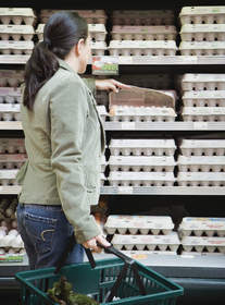 Woman shopping for eggs