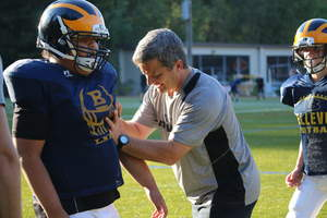 ATAVUS Head of Football Rex Norris demonstrates rugby style tackling technique to a Bellevue (WA) junior football player as part of a program to improve the effectiveness and safety of the game.