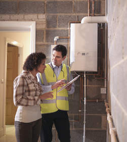 Woman and man discussing water heater options.