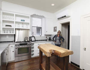 Nicole Curtis standing in a renovated kitchen.