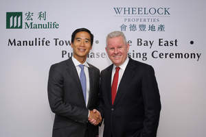 Mr. Michael Huddart(Right), Manulife's Executive Vice President and General Manager for Greater China and Mr. Douglas Woo, Vice Chairman and Managing Director of Wheelock Properties Limited, pictured at the purchase closing ceremony of Manulife Tower