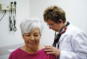 Woman getting a check-up from her doctor.