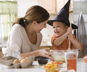 Mother and child baking for Halloween