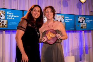 Tito's Handmade Vodka was recognized for their Vodka for Dog People campaign at the annual Found Animals Gala at the SLS Hotel.  Vodka for Dog People donates proceeds from its site to Emancipet, an animal welfare organization that makes spay/neuter services and preventive veterinary care affordable and accessible to all pet owners. Elizabeth Bellanti, Relationship Manager at Tito's Vodka, receives her award with Emancipet board member, Mona Patel.
