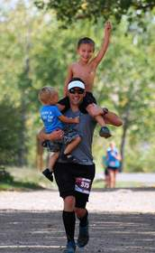 Coda Coffee co-founder, Tommy Thwaites carries son Cash while Memphis gets a ride on Dad's shoulders.