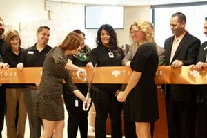 Branch staff cuts ribbon at Burnsville opening
