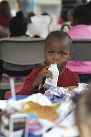 Young boy drinking milk.