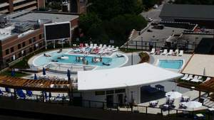 A dynamic parking garage renovation uses light weight foam to add a pool and lounge area.