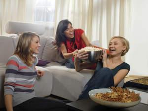Women sharing popcorn