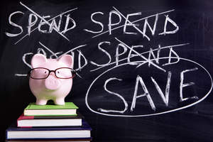 Piggy bank wearing glasses with chalkboard backdrop with the word Save circled.