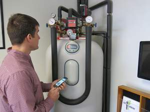 With AutoGrid DROMS the NHEC field services team can have an installer come on-site to install load control devices on water heaters, space heaters and air conditioners and then easily provision them in the DR program through a mobile app. Photo Credit: New Hampshire Electric Cooperative (NHEC).