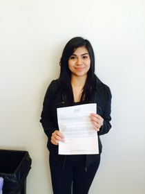 Brisa Aguilar-Velazquez with her acceptance letter to the High School High Scholars (HS)2 program.