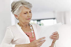 Woman looking at paperwork.