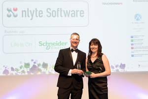 James Stuart, Nlyte Director, EMEA Sales, receives  Data Centre Solutions' DCIM Product of the Year award trophy from Emily Gallagher of Touchdown PR.
