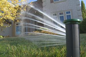 Digitally controlled, multi-stream sprinkler heads water in the exact shape of any lawn