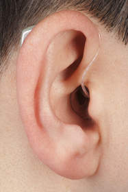 Ear worn device for tinnitus or hearing loss