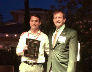 Alex Berber (l), Business Development Manager for Mi Rancho, accepts the Hall of Fame plaque from Jim Kabbani (r), CEO of the Tortilla Industry Association