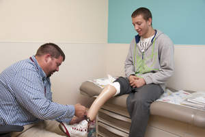 Darren Rottmann fits a patient for a prosthetic leg