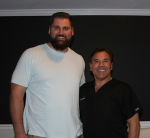 Hair restoration patient and NE Patriots offensive lineman Sebastian Vollmer with Dr. Robert Leonard