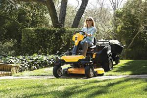 women on lawn mower